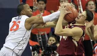 Boston College guard Danny Rubin (31) grabs a rebound in front of Virginia forward Akil Mitchell (25) during the second half of an NCAA college basketball game in Charlottesville, Va., Wednesday, Feb. 5, 2014. Virginia won the game 77-67. (AP Photo/Steve Helber)
