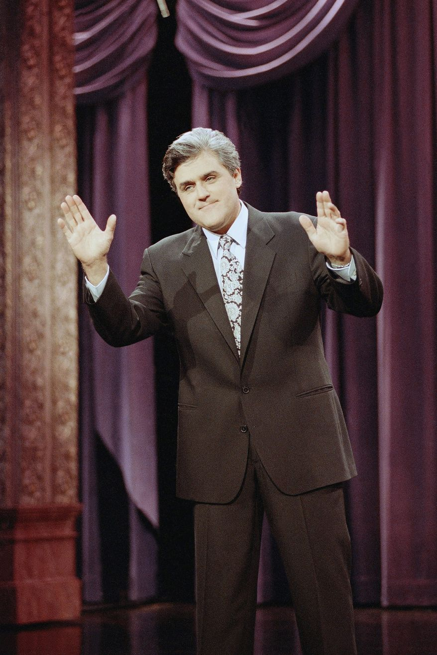 """Jay Leno gestures during the opening monologue at the inauguration of """"The Tonight Show with Jay Leno"""" which was broadcast live on the east coast from NBC Studios in Burbank, Calif., May 25, 1992. The show features a new band with jazz musician Branford Marsalis as musical director. Leno's first guests were comedian Billy Crystal and singer Shanice. (AP Photo/Craig Fujii)"""