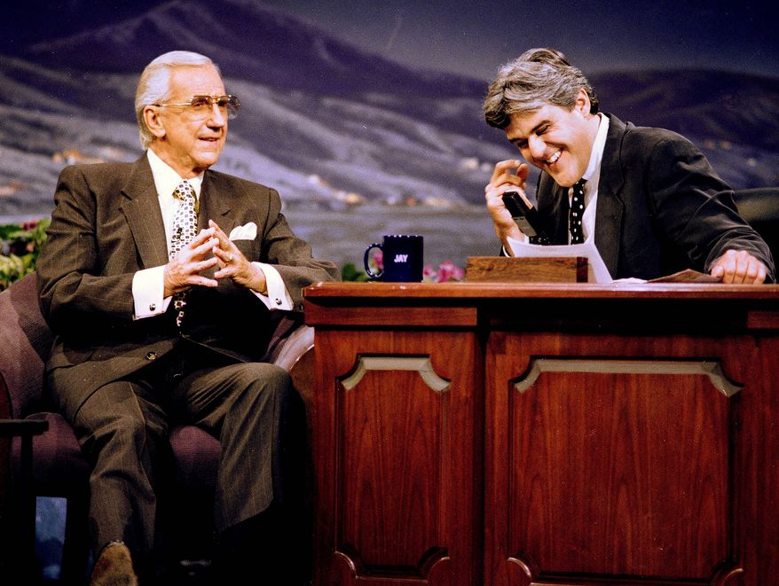 "FILE - In this July 30, 1993 file photo, Ed McMahon, left, former announcer of the ""Tonight Show,"" looks on as ""Tonight Show"" host Jay Leno breaks into laughter during the taping of the show in Burbank, Calif. McMahon, the loyal ""Tonight Show"" sidekick who bolstered boss Johnny Carson with guffaws and a resounding ""H-e-e-e-e-e-ere's Johnny!"" for 30 years, has died at a Los Angeles hospital. He was 86. (AP Photo/Kevork Djansezian, file)"