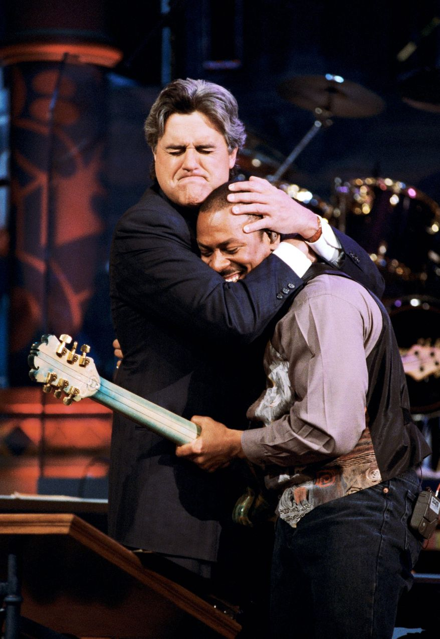 "This April 26, 1995 photo released by NBC shows host Jay Leno embracing bandleader Kevin Eubanks on ""The Tonight Show with Jay Leno,"" in Burbank, Calif. After 22 years, Leno will host his last show on Thursday, Feb. 6, 2014. (AP Photo/NBC, Margaret Norton)"