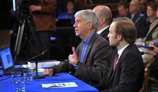 Michigan Gov. Rick Snyder presents the budget to the combined House and Senate Appropriations Committees at the Capitol in Lansing, Mich., Wednesday. Feb. 5, 2014. Lt. Gov. Brian Calley, right, and Budget Director John Nixon flank the Governor. (AP Photo/Detroit News, )  DETROIT FREE PRESS OUT; HUFFINGTON POST OUT