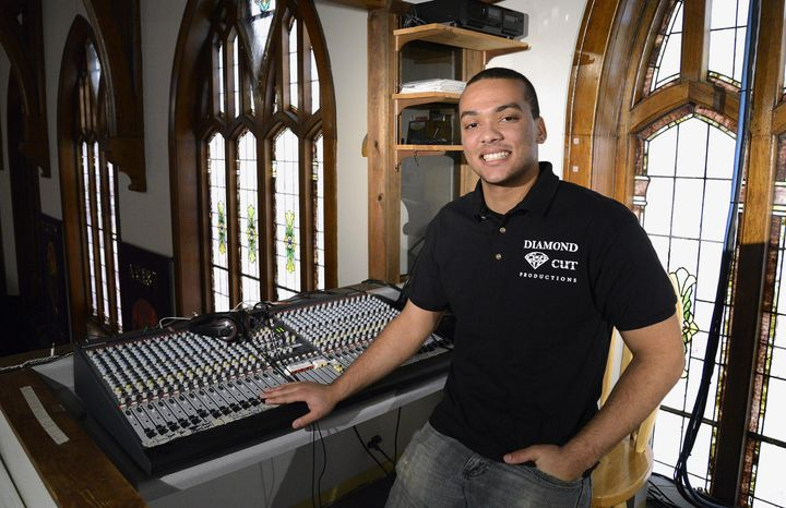 In this Jan. 16, 2014 photo, Breje Whitt, 17, poses for a photo in the sound booth at Family Life Church in Elgin, Ill. Whitt is an entrepreneur who launched his own DJ, sound and lighting company called Diamond Cut Productions. (AP