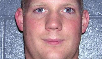 FILE - This undated file photo, supplied by the Mahnomen  County sheriff's office, shows sheriff's deputy Christopher Dewey, who was shot and critically wounded Feb. 18, 2009, in Mahnomen, Minn., and died about 18 months later. The Minnesota Supreme Court has affirmed all but one of the guilty verdicts against Thomas Lee Fairbanks including first-degree murder of a peace officer. One of four assault counts was reversed by the high court. (AP Photo/ Mahnomen County Sheriff's Office)