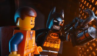 "This image released by Warner Bros. Pictures shows characters Emmet, voiced by Chris Pratt, left, and Batman, voiced by Will Arnett, in a scene from ""The Lego Movie."" (AP Photo/Warner Bros. Pictures)"