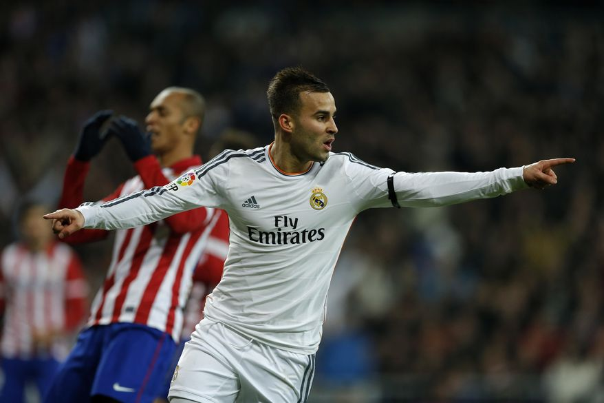 Real's Jese Rodriguez celebrates after scoring during a semi final, 1st leg, Copa del Rey soccer derby match between Real Madrid and Atletico Madrid at the Santiago Bernabeu Stadium in Madrid, Wednesday Feb. 5, 2014.  (AP Photo/Paul White)