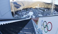 The photo taken with a fisheye lens show the start area on the large hill of the ski jumping stadium for the 2014 Winter Olympics, Tuesday, Feb. 4, 2014, in Krasnaya Polyana, Russia. (AP Photo/Dmitry Lovetsky)