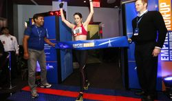 Australia's Suzy Walsham celebrates as she wins the women's division of the Empire State Building Run-Up, Wednesday, Feb. 5, 2014, in New York. Walsham, who was also last year's champion, has now won the race a record five times. (AP Photo/Jason DeCrow)