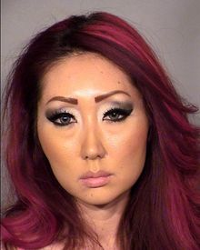 File-A Feb. 3, 2014, file photo provided by Clark County Fire Department, shows  Gloria Eun Hye Lee at the Clark County Detention Center in Las Vegas. Lee faces felony conspiracy and arson charges in the early Jan. 27, 2014, fire at the Prince & Princess Puppy Boutique in Las Vegas. A hearing for a Las Vegas pet shop owner accused of trying to burn her store with 27 puppies inside drew animal rights protestors and more charges from prosecutors who sought to have her jailed at least until her preliminary hearing on multiple felony charges. (AP Photo/Clark County Fire Department ,File)