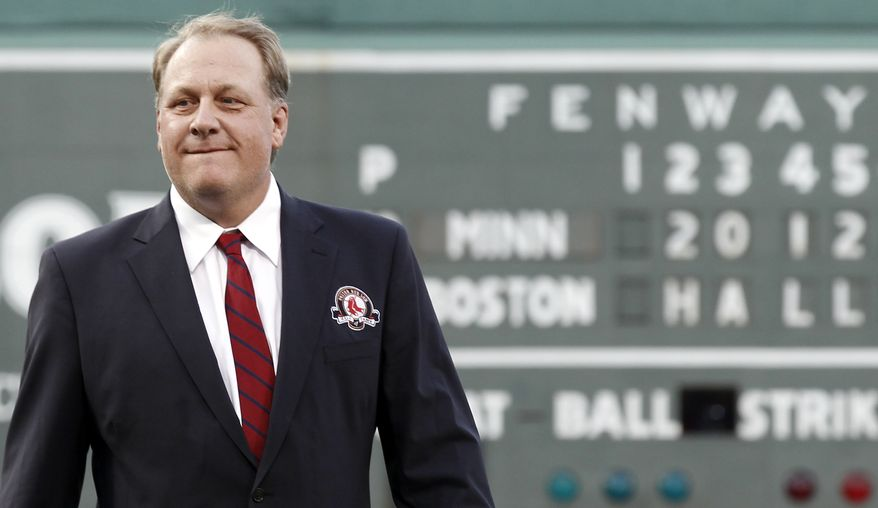 **FILE** Former Boston Red Sox pitcher Curt Schilling looks on after being introduced as a new member of the Boston Red Sox Hall of Fame before the baseball game between the Boston Red Sox and the Minnesota Twins at Fenway Park in Boston Friday, Aug. 3, 2012. (AP Photo/Winslow Townson)