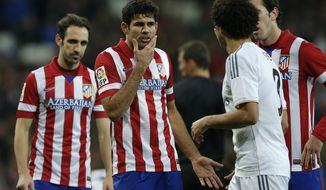 Atletico's Diego Costa, 2nd left has words with Real's Pepe, 3rd right during a semi final, 1st leg, Copa del Rey soccer derby match between Real Madrid and Atletico Madrid at the Santiago Bernabeu Stadium in Madrid, Wednesday Feb. 5, 2014.  (AP Photo/Paul White)