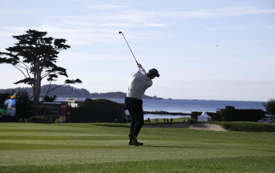 Denver Broncos quarterback Peyton Manning hits from the fairway down to the third green of the Pebble Beach Golf Links during a practice round for the AT&T Pebble Beach Pro-Am golf tournament Wednesday, Feb. 5, 2014, in Pebble Beach, Calif. (AP Photo/Eric Risberg)