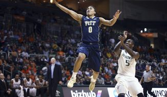 Pittsburgh' James Robinson (0) runs past Miami's Davon Reed (5) for two points during the first half of an NCAA college basketball game in Coral Gables, Fla., Wednesday, Feb. 5, 2014. (AP Photo/J Pat Carter)