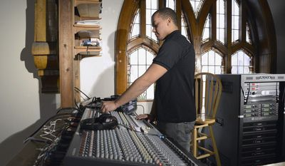 In this Jan. 16, 2014 photo, Breje Whitt, 17, operates the sound board at Family Life Church in Elgin, Ill. Whitt is already an entrepreneur at his young age after launching his own DJ, sound and lighting company called Diamond Cut Productions. (AP Photo/Daily Herald, Laura Stoecker)  MANDATORY CREDIT, MAGS OUT