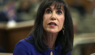 Judge Gail Prudenti of the New York State Office of Court Administration testifies during a joint legislative budget hearing on public protection on Wednesday, Feb. 5, 2014, in Albany, N.Y. (AP Photo/Mike Groll)