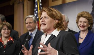 Senate Agriculture Committee member Sen. Heidi Heitkamp, D-N.D., center, joined by fellow committee members, gestures during a news conference on Capitol Hill in Washington, Tuesday, Feb. 4, 2014, after congressional approval of a sweeping five-year farm bill that provides food for the needy and subsidies for farmers. From left are, Sen. Amy Klobuchar, D-Minn., Sen. John Hoeven, R-N.D., Heitkamp, the committee's ranking member, Sen. Thad Cochran, R-Miss. and committee chair Sen. Debbie Stabenow, D-Mich.  (AP Photo/J. Scott Applewhite)