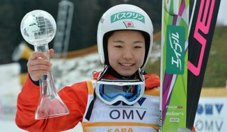 Japan's winner Sara Takanashi pose for media after the Ski Jumping World Cup Ladies event in Hinzenbach, Austria, on Sunday, Feb. 2. 2014. (AP Photo/Kerstin Joensson)