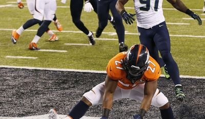 10ThingstoSeeSports - Denver Broncos running back Knowshon Moreno (27) recovers a fumble in the end zone for a safety after a bad snap in the first half of the NFL Super Bowl XLVIII football game against the Seattle Seahawks, Sunday, Feb. 2, 2014, in East Rutherford, N.J. (AP Photo/Kathy Willens, File)