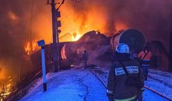 In this photo provided by the Ministry of Emergency Situations Kirov Branch press service, firefighters watch burning tankers early Wednesday, Feb. 5, 2014, near Posdino in Kirov region of Russia, some 800 km ( about 500 miles) northeast of Moscow. 32 tankers were derailed and 12 of them burned. No casualties were reported. (AP Photo/Ministry of Emergency Situations, Kirov Branch Press Service) EDITORIAL USE ONLY