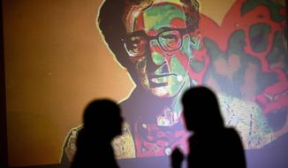 """An image of U.S. director Woody Allen is projected on a wall at an art exhibit titled """"Queremos tanto a Woody,"""" or """"We so love Woody"""" by Argentine artist Hugo Echarri in Buenos Aires, Argentina, Thursday, Feb. 6, 2014. The exhibit in honor of Allen was inaugurated just days after the artist faced renewed accusations that he molested Dylan Farrow, his then-7-year-old adopted daughter in 1992. (AP Photo/Rodrigo Abd)"""