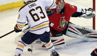 Ottawa Senators goaltender Craig Anderson pushes the puck away from Buffalo Sabres' Tyler Ennis (63) during the second period of an NHL hockey game, Thursday, Feb. 6, 2014 in Ottawa, Ontario. (AP Photo/The Canadian Press, Fred Chartrand)