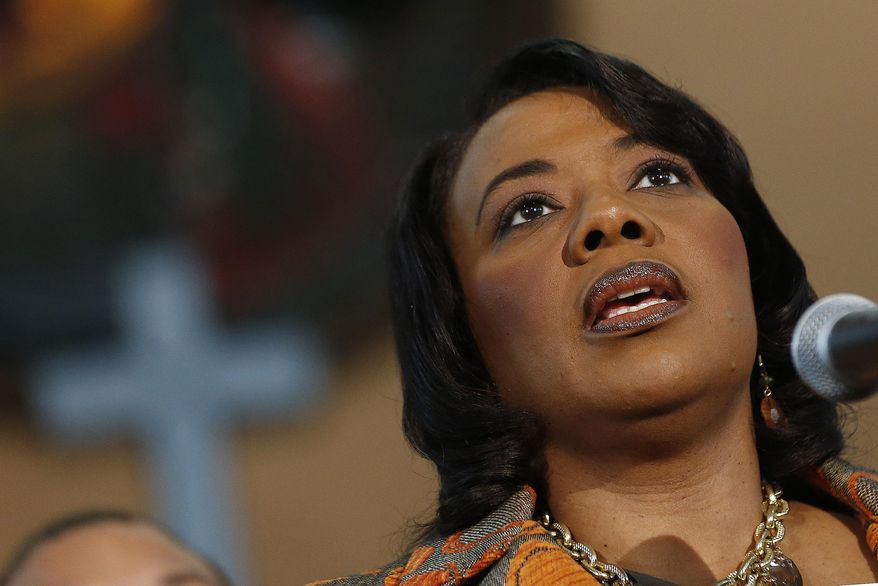 Bernice King speaks during a news conference Thursday, Feb. 6, 2014, in Atlanta.at Ebenezer Baptist Church where her father Martin Luther King Jr. preached.  King is in a legal battle with her brothers over her father's Bible and Nobel Peace Prize medal.  (AP Photo/John Bazemore)