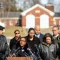 'Too many' The family of Medric Cecil Mills Jr. surrounds attorney Karen Evans as she says they are fighting the District not only on behalf of the man who died after medics refused to treat him, but also for other casualties of the city's public duty doctrine. (Andrew Harnik/The Washington Times)