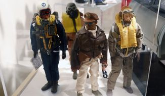 ** FILE ** This Jan. 31, 2014, photo shows Tuskegee Airmen G.I. Joe action figures in a display at the New York State Military Museum in Saratoga Springs, N.Y. (AP Photo/Mike Groll)