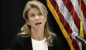 FILE - In this Jan. 9, 2014 file photo, Texas Sen. Wendy Davis speaks at an education roundtable meeting in Arlington, Texas.  Davis, who has said she would support expanding gun rights, now says that includes allowing concealed handgun license holders to openly carry their weapons in public. (AP Photo/LM Otero, File)