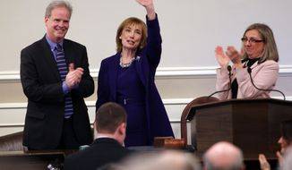 New Hampshire Gov. Maggie Hassan, D-N.H., waves to supporters with her husband Tom, and Speaker of the House Terie Norelli, as she arrives for the State of the State address at the Statehouse Thursday, Feb. 6, 2014 in Concord, N.H. (AP Photo/Jim Cole)