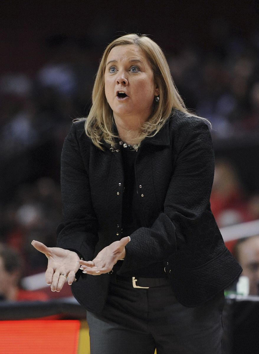 Pittsburgh coach Suzie-McConnell-Serio calls to her team during the first half of an NCAA college basketball game against Maryland on Thursday, Feb. 6, 2014, in College Park, Md. (AP Photo/Gail Burton)