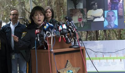 Alachua County Sheriff Sadie Darnell announces to the gathered media that detectives have identified a suspect, Paul Rowles, in the 1989 disappearance of University of Florida student Tiffany Sessions, Thursday, Feb. 6, 2014 in Gainsville, Fla. Rowles, a serial killer, died in prison last year. (AP Photo/Phil Sandlin)