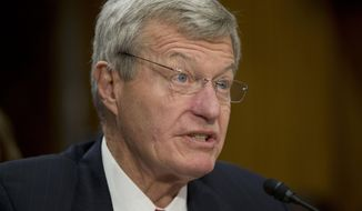 FILE - This Jan. 28, 2014 file photo shows retiring Montana Sen. Max Baucus testifying on Capitol Hill in Washington before the Senate Foreign Relations Committee hearing on his nomination to become US ambassador to China. The Senate was preparing Thursday to confirm veteran Baucus as ambassador to China, handing the job to a lawmaker who is familiar with U.S. trade policy but has little expertise about military and other issues that have caused tensions in recent years with Beijing.  (AP Photo/Pablo Martinez Monsivais, File)