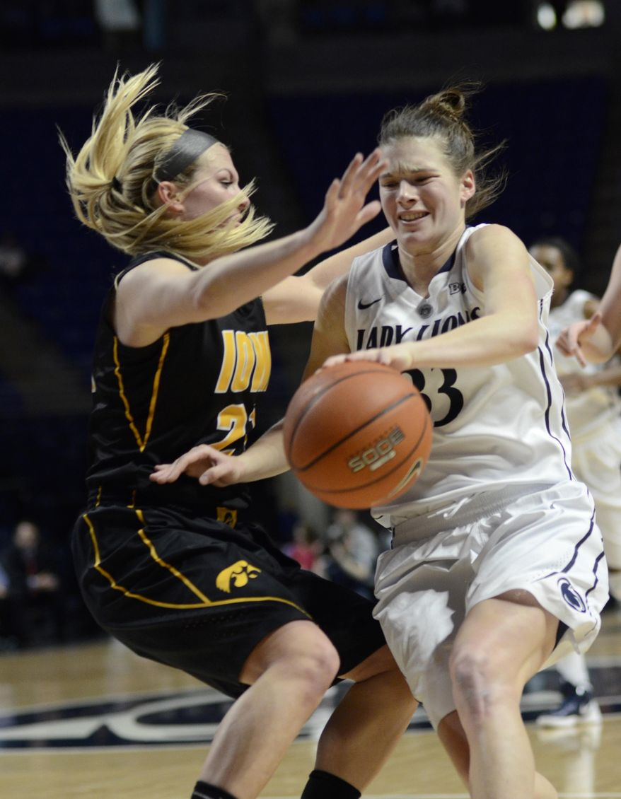Penn State's Maggie Lucas (33) is fouled by Iowa's Kali Peschel (25) during first half  of an NCAA college basketball game on Thursday, Feb. 6, 2014 in State College, Pa. (AP Photo/Ralph Wilson)