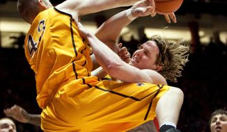 New Mexico's Cameron Bairstow, right, is fouled attempting a shot in front of Wyoming's Matt Sellers in the first half of an NCAA college basketball game Wednesday, Feb. 5, 2014 in Albuquerque, N.M. (AP Photo/Eric Draper)