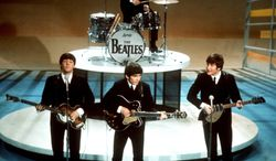 """FILE - In this Feb. 9, 1964 file photo, The Beatles, from left, Paul McCartney, George Harrison, Ringo Starr on drums, and John Lennon perform on the CBS """"Ed Sullivan Show"""" in New York.  The Beatles made their first appearance on """"The Ed Sullivan Show,"""" America's must-see weekly variety show, on Sunday, Feb. 9, 1964. And officially kicked off Beatlemania. (AP Photo, File)"""