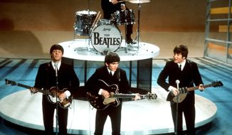 "FILE - In this Feb. 9, 1964 file photo, The Beatles, from left, Paul McCartney, George Harrison, Ringo Starr on drums, and John Lennon perform on the CBS ""Ed Sullivan Show"" in New York.  The Beatles made their first appearance on ""The Ed Sullivan Show,"" America's must-see weekly variety show, on Sunday, Feb. 9, 1964. And officially kicked off Beatlemania. (AP Photo, File)"