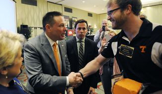 University of Tennessee head football coach Butch Jones is greeted by Daniel Williams after speaking at a legislative planning session sponsored by The Associated Press and the Tennessee Press Association on Thursday, Feb. 6, 2014, in Nashville, Tenn. Jones was the recipient of the Tennessee Press association Headliner of the Year Award. (AP Photo/Mark Zaleski)