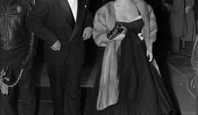 FILE - In this Dec. 21, 1949, file photo, Elizabeth Taylor arrives for a Hollywood movie premiere with Pittsburgh Pirates' Ralph Kiner, in Los Angeles. The baseball Hall of Fame says slugger Ralph Kiner has died. He was 91. The Hall says Kiner died Thursday, Feb. 6, 2014, at his home in Rancho Mirage, Calif.  (AP Photo/File)