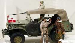 This Jan. 31, 2014, photo shows a Gen. George Patton G.I. Joe action figure, right, and other G.I. Joes in a display at the New York State Military Museum in Saratoga Springs, N.Y. A half-century after the 12-inch doll was introduced at a New York City toy fair, the iconic action figure is being celebrated by collectors with a display at the military museum, while the toy's maker plans other anniversary events to be announced later this month. (AP Photo/Mike Groll)