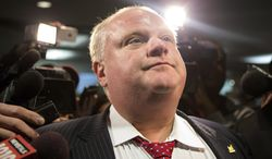** FILE ** In this file photo from Jan. 30, 2014, Toronto Mayor Rob Ford is questioned by reporters in Toronto. (AP Photo/The Canadian Press, Chris Young, File)