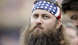 Willie Robertson from the TV show Duck Dynasty watches from the sideline in the second half of an NCAA college football game  between LSU and Florida in Baton Rouge, La., Saturday, Oct. 12, 2013.  LSU won 17-6. (AP Photo/Gerald Herbert) ** FILE **