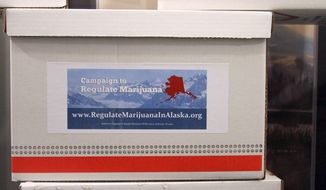 ** FILE ** Boxes containing more than 46,000 signatures for an initiative to make recreational use of marijuana legal in Alaska sit outside a hallway at the state Division of Elections office in Anchorage, Alaska, on Wednesday, Jan. 8, 2014. If the state verifies there are enough valid signatures, the measure will appear on the Alaska primary ballot on Aug. 19, 2014. (AP Photo/Mark Thiessen)