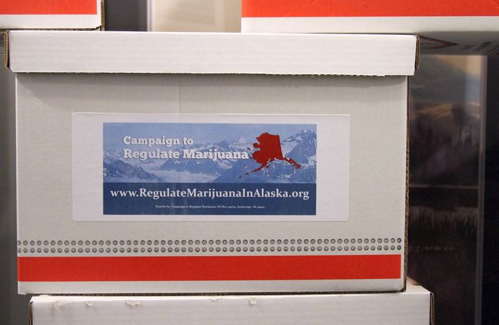** FILE ** Boxes containing more than 46,000 signatures for an initiative to make recreational use of marijuana legal in Alaska sit outside a hallway at the state Division of Elections office in Anchorage, Alaska, on Wednesday, Jan. 8, 2014. I
