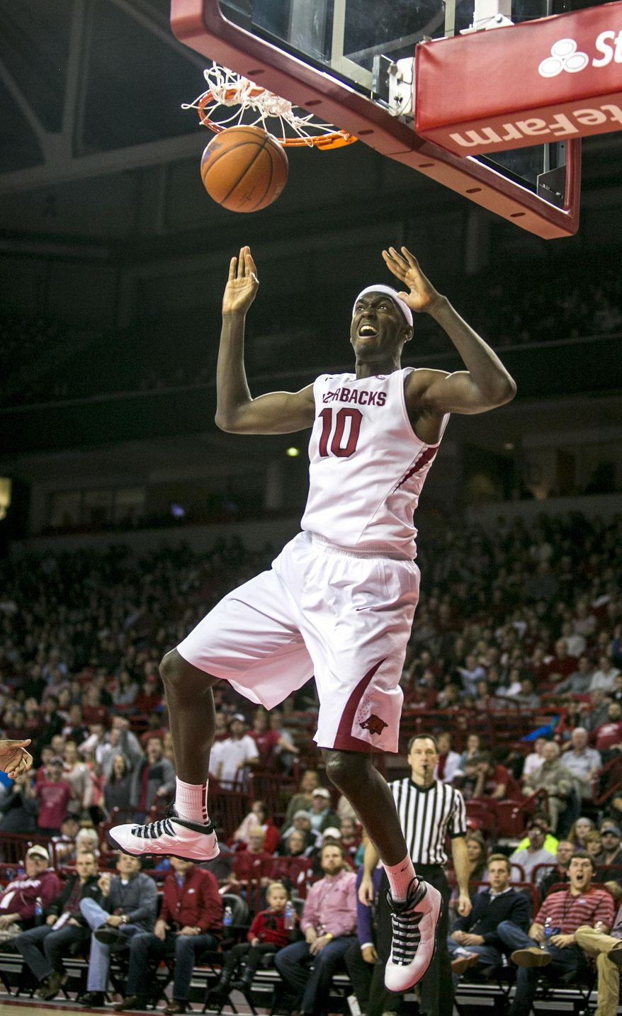 Arkansas forward Bobby Portis (10) slams an alley-oop dunk during the first half of an NCAA college basketball game against Alabama, Wednesday, Feb. 5, 2014, in Fayetteville, Ark. Arkansas defeated Alabama 65-58. (AP Photo/Gareth Patterson)