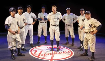 "This image released by Polk & Co. Peter Scolari, portraying baseball legend Yogi Berra, right, and the cast from the play, ""Bronx Bombers,"" which examines the rich history of the New York Yankees. (AP Photo/Polk & Co., Joan Marcus)"