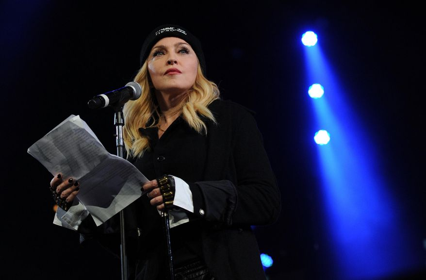 """Madonna participates in Amnesty International's """"Bringing Human Rights Home"""" Concert at the Barclays Center on Wednesday, Feb. 5, 2014 in New York. (Photo by Evan Agostini/Invision/AP)"""