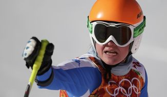 Italy's Verena Stuffer gestures in the finish area after completing a women's downhill training run at the Sochi 2014 Winter Olympics, Thursday, Feb. 6, 2014, in Krasnaya Polyana, Russia.  AP Photo/Gero Breloer)