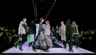 Models walk in the finale of the Fall 2014 BCBG Max Azria collection during Fashion Week in New York,  Thursday, Feb. 6, 2014. (AP Photo/Richard Drew)