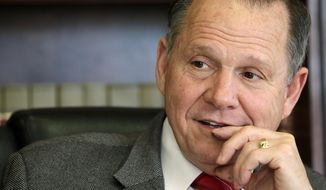 FILE -- In this Oct. 24, 2012 file photo, former Chief Justice Roy Moore poses for a photo in his Montgomery, Ala., office. Alabama's chief justice is trying to start a national movement to add an amendment to the U.S. Constitution defining marriage as the union of one man and one woman. In an interview with The Associated Press, Chief Justice Roy Moore said some judges have found new rights for gay unions that didn't exist before and the only way to stop them is with a state-initiated constitutional amendment. (AP Photo/Dave Martin)