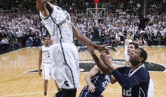 Michigan State's Adreian Payne, left, shoots over Penn State's Jordan Dickerson (32) and Ross Travis (43) during the first half of an NCAA college basketball game on Thursday, Feb. 6, 2014, in East Lansing, Mich. (AP Photo/Al Goldis)